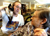 THERAPY_CAT_N0728CAT2.jpg  Julian Alexander (cq)(left) lets his cat, Binky, sit on his shoulder...