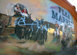 Lafayette Collectibles and Flea Market has a western theme mural by Flat Rabbit Murals decorating...