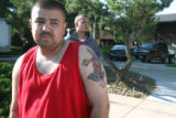 Bobby Rivera (cq), 30, stands in  the 6000 block of West Yale Avenue early Monday morning July...