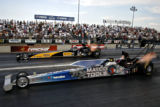 Rod Fuller (gold and black) and Whit Bazemore (blue) face off for the Top Fuel Championship on...