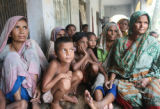 DHA104 - Bangladeshi flood victims sit at a relief center in Khoksha, at Sirajgong district, 104...