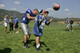 Henry Cuntzelman (CQ),8, of Colorado Springs gets an autograph from Air Force quarterback Shaun...