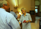 Colorado Governor Bill Ritter talks with Edna Pelzmann, manager of visitor services, at the...