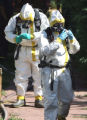 Members of the Denver Police Vice and Narcotics unit exit a meth lab to be  decontaminated after...