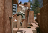 Hunter Neiblum (cq), 15, of Evergreen, runs off a wall while practicing Parkour in downtown...