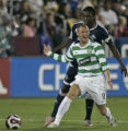 Celtic FC's Kenny Miller, front, argues a call being defended by MLS All-Star Shalrie Joseph,...