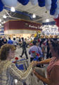 Irene Apgar gave out flowers during the opening of the new commissary on Peterson Air Force Base...
