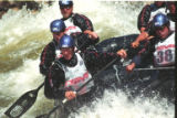 Rafting Team Behind the 8 Ball competes in the Rafting Cross racing through Dowd Chutes on the...