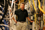 Pieter Poll, is Qwest's chief technology officer, stands in Qwest's switching center in Littleton....