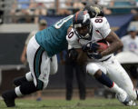 (JACKSONVILLE, FLA., SEPTEMBER 19, 2004) - Denver Broncos' #80, Rod Smith, trys to sidestep ...