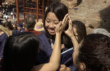 ( MORRISON, Co., May 20, 2004) Sarah Chan , a Thunder Ridge H.S. senior is congratulated by her...