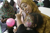 Aliyaa Negawo, 3, feeds cotton candy to her aunt, Feiruza Ali(cq) at the open house put on by the...