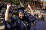 ( MORRISON, Co., May 20, 2004) Sarah Chan , a Thunder Ridge H.S. senior holds her arms up in...