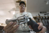 DLM0619  Tim Brough, 45, owner of Rocky Mountain Shooters Supply, displays a Smith and Wesson 357...