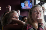 Rici Smith (cq) left and Cindy Lou Penistom  join fellow democrats at The Tavern Uptown in Denver...