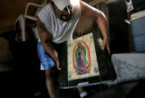 Gustavo Puga (CQ), 28, of Holly,Colo., moves the head stone that bears the name of his wife,...