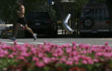 A lone unidentified runner takes the heat and the workout running laps at Washington Park on...