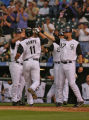 Rockies Brad Hawpe is greeted at home by Todd Hilton, right, and other players after hitting a 3...