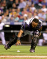 Rockies catcher, Yorvit Torrealba, tries to make a play on a punt from Brewers Tony Graffanino, in...