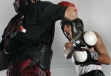 Robert Rodriguez,17, right, tries to dodge a blow from 17-0 (KO-11) Welerweight fighter Mike...