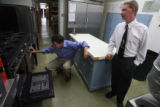 (l to r) Speaker of the House Andrew Romanoff (cq) , D-Denver, inspects an oven with Liberty...