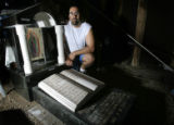 CODER101 - Gustavo Puga (CQ), 28, of Holly,Colo., kneels as the grave stone for his wife, Rosemary...