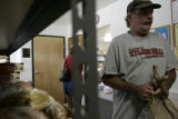 Merlin Weidman(cq) helps a neighbor pick up her box of food at the Arvada Food Bank in Arvada,...