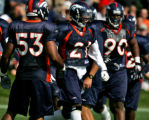 The Denver Broncos safety Hamza Abdullah, middle, is celebrated by teammates Louis Green, left,...