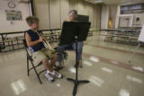 Charlie Childers, 11, works on trumpet skills with Stephanie Sowter, (cq both) between classes....