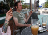 (from left) Hunter Dragon (Cq) and Kent Evenson (cq) enjoy their summer evening at Pablo's Cafe on...