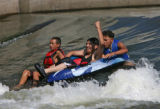 Noel Loya (cq), Eliseo Juarez (cq) and Luis Mondosa (cq), left to right, enjoy a raft ride on the...