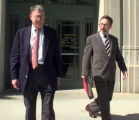Former IUSB Chancellor Daniel Cohen, with his attorney, John Hamilton, leaves Northern Indiana...