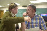Jill Anderson, an Indiana University South Bend student, talks with physics professor Daniel Cohen...