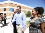 DA Ken Buck laughs with Rafael Mendoza with fiancee Meghan Gregory after Mitch Cozad was found...