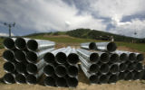 Stacks of pipes that will be used in the headwall slope improvement, lay at the base of the ...