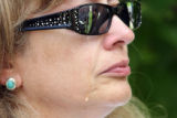 Amida Martinez (cq) sheds a tear for her son, 24 year-old SGT Michael Martinez who was killed in...