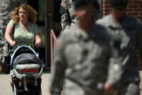 Family and friends exit the Soldiers Memorial Chapel at Fort Carson, after a service held for the...
