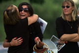 (from left) Misty Althouse (cq), a friend of the Martinez family comforts Ashley Elizabeth...