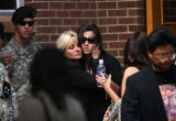 (from left) Elizabeth Giroux (cq) hugs her daughter, Ashley Elizabeth Martinez (cq) at the end of...