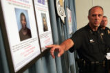 Denver PD Chief Whitman points to photos of suspects wanted for murder, John Toole and Yahya Abdul...
