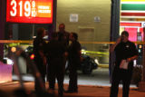 DLM1924   Police at a 7/11 store at Federal and 10th where three police officers were shot during...