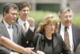 0204 Former Qwest CEO Joe Nacchio, leaves the Alfred A. Arraj Federal Courthouse with his wife...