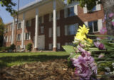 (Fort Collins, Colo., September 7, 2004)  A bouquet of flowers sit on the ground outside the Sigma...
