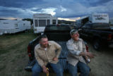 MJM294 Oil and gas workers, Michael Hoffpowier (cq), left, and Brady Oncale (cq) drink beer at...