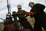 MJM306 EnCana Oil and Gas Inc. workers, Matt Keaney (cq), left center, and Damien Wissink (cq),...