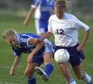 Golden, Colo., photo taken May 20, 2004- Denver Christian forward, Michelle Koele (left #11), and...