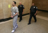 Lawrence Trujillo, 36, walks from court to jail after he plead guilty Monday July 30, 2007 to all...