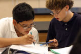 12 year-olds (from left) Dar Dye (cq) and Randy Juarez (cq) team up as they review their notes in...