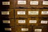 DLM3861  Stacks of wooden drawers labeled for different types of seeds wait to be moved in the...