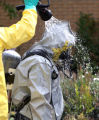 A member of the Boulder County Drug Task Force gets decontaminated at the scene of a suspected...